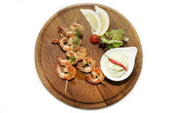 Skewers of shrimp Stock Images