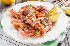 Skewers of shrimp wrapped in bacon Stock Images