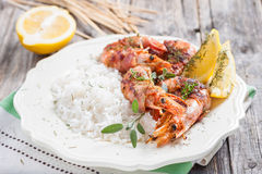 Skewers of shrimp wrapped in bacon royalty free stock photo