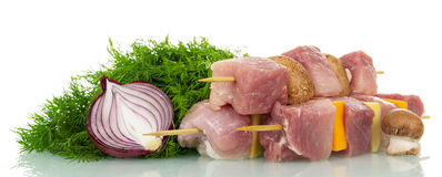 Skewers with slices fresh pork, vegetables, mushrooms, dill, onion isolated. Stock Image