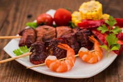 Skewers of smoked salmon on  with prawns and vegetables Royalty Free Stock Images
