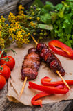 Skewers of smoked salmon on  with prawns and vegetables Stock Photos