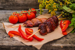 Skewers of smoked salmon on  with prawns and vegetables Stock Image