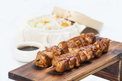 Skewers with soya sauce and rice Stock Images