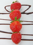 Skewers strawberries Royalty Free Stock Photo
