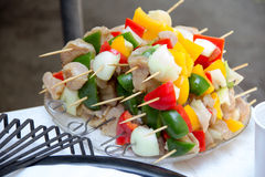 Skewers. Stuffed chicken meat, peppers different colors, yellow, red, green, onion, in isolation Stock Images