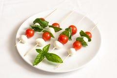 Skewers of tomato, mozzarella and basil Stock Photos