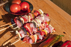 Skewers and vegetables. On the table Royalty Free Stock Photography