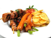 Skewers and vegetables Stock Image