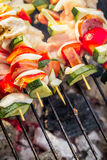 Skewers with vegetables on the grill Royalty Free Stock Images
