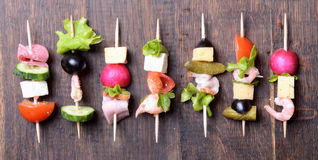 Skewers on wooden background stock image
