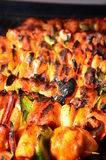 Skewers on wooden stick with tasty chicken meat and vegetables mix Royalty Free Stock Images