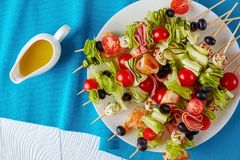 Skewers with vegetables, meat and cheese stock images