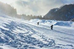 Skiërs in Bansko Stock Afbeeldingen