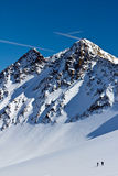 Ski-alpinist the tip of the iceberg. In the Alps Royalty Free Stock Photo