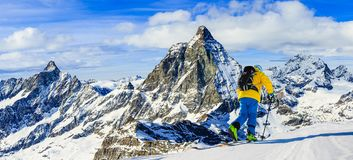 Ski with amazing view of swiss famous mountains in beautiful winter snow Mt Fort. The skituring, backcountry skiing in fresh stock image