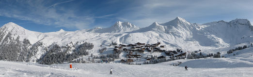 Ski area. A photo of a ski area with a skyline of mountains royalty free stock photo