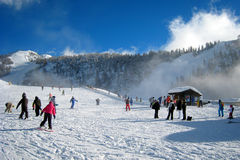 The Ski Area. Skiers and swowboarders in italian alps Stock Photos