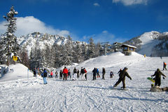 The Ski Area. Skiers and swowboarders in italian alps Royalty Free Stock Photo
