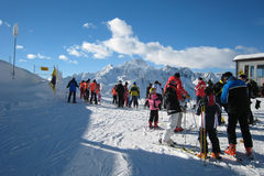 The Ski Area. Skiers and snowboarders in ski area Stock Images