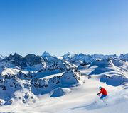 Ski area with amazing view of swiss famous mountains in beautiful winter snow Mt Fort. The matterhorn and the Dent d`Herens. In royalty free stock images