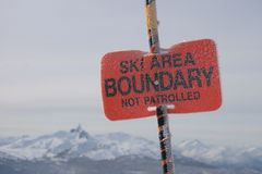 Ski Area Boundary. A closeup of a sign indicating the ski area boundary separates the hill from the backcountry Royalty Free Stock Photos