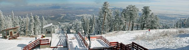 Ski area panorama. True panorama of the top of the ski lift and area on the top of the Sandia Mountains in New Mexico, just after the first snow of winter, and Royalty Free Stock Photos