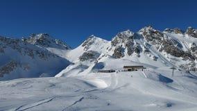 Ski area Pizol, summit station and mountains Stock Photo