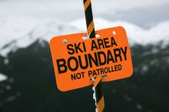 Ski area trail boundary sign. Royalty Free Stock Images