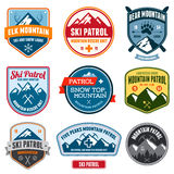 Ski badges. Set of ski patrol mountain badges and patches royalty free illustration