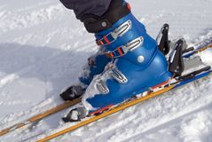 Ski Boots. The ski boots of a ten year old girl as she prepares to descend a slope royalty free stock photos