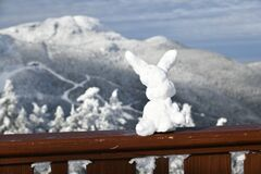 Ski bunny snow sculpture at Stowe Ski Resort in Vermont, view to the Mansfield mountain slopes