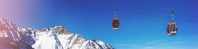 ski cable cars over mountain landscape on sunny day stock photo