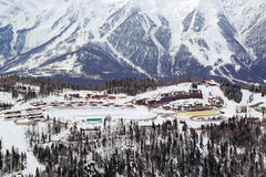 Ski centre. SOCHI, RUSSIA - MAR 02, 2014: Krasnaya Polyana - alpine ski Resort, venue for the 2014 winter Olympics. The ski centre Gazprom JSC, top view royalty free stock photo