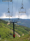 Ski chair Lift -1. Ski chair Lift with mountains in background -1 Stock Photography