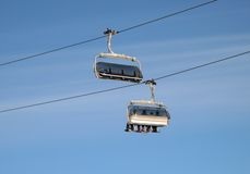 Ski chair-lift. With skiers Stock Images