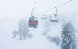 Ski chair lift. With skiers at Troodos mountains in Cyprus Stock Photos
