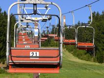 Ski chair lift. Empty ski chair lift in summer Royalty Free Stock Photography