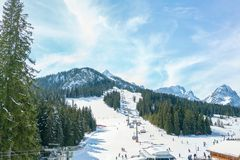 Ski chair lift in the alps of Germany against the blue sky and mountains. stock images