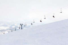 Ski Chair Lift Ascending Mount Annipuri in Niseko, Japan Royalty Free Stock Photos