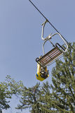 Ski chair lift carry summer toboggan sled. Against blue sky Royalty Free Stock Photos