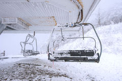 Ski chair lift is covered by snow in winter. Ski chair lift is covered by snow in winter, Korea Stock Photo