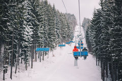 Ski chair lift with skiers. In carpathian mountains, Ukraine Royalty Free Stock Images