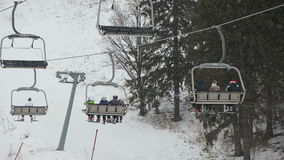 Ski chair lift with skiers stock video