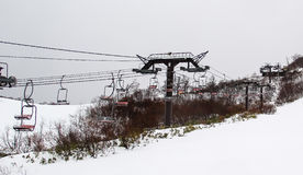 Ski chair lift. With skiers on mountain Royalty Free Stock Images