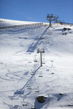 Ski chair lift with skiers. Ski resort in Sierra Nevada Royalty Free Stock Photos