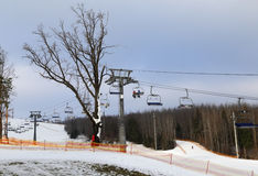 Ski chair-lift with skiers. Royalty Free Stock Image