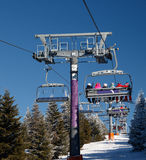 Ski chair lift with skiers. And snowboarders Stock Photo