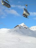 Ski chair-lift with skiers. Switzerland. Stock Image