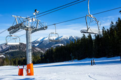 Ski chair lift on winter resort. Ski chair lift on mountain resort in nice winter day Royalty Free Stock Photos